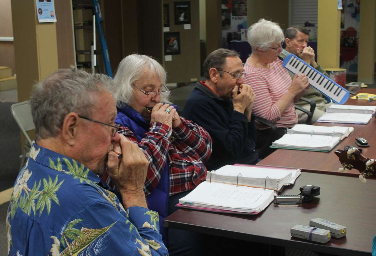 Members of Harmonicas in Class - a local group who play harmonica, hammered dulcimer, banjo, guitar and melodica - gathered Tuesday morning at Artworks to play a variety of tunes as part of the annual Festival of the Arts.