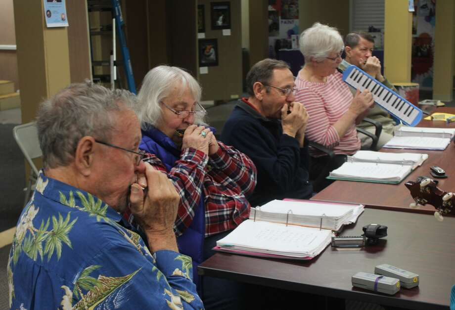 Members of Harmonicas in Class — a local group who play harmonica, hammered dulcimer, banjo, guitar and melodica — gathered Tuesday morning at Artworks to play a variety of tunes as part of the annual Festival of the Arts. Photo: (Pioneer Photo/Taylor Fussman)