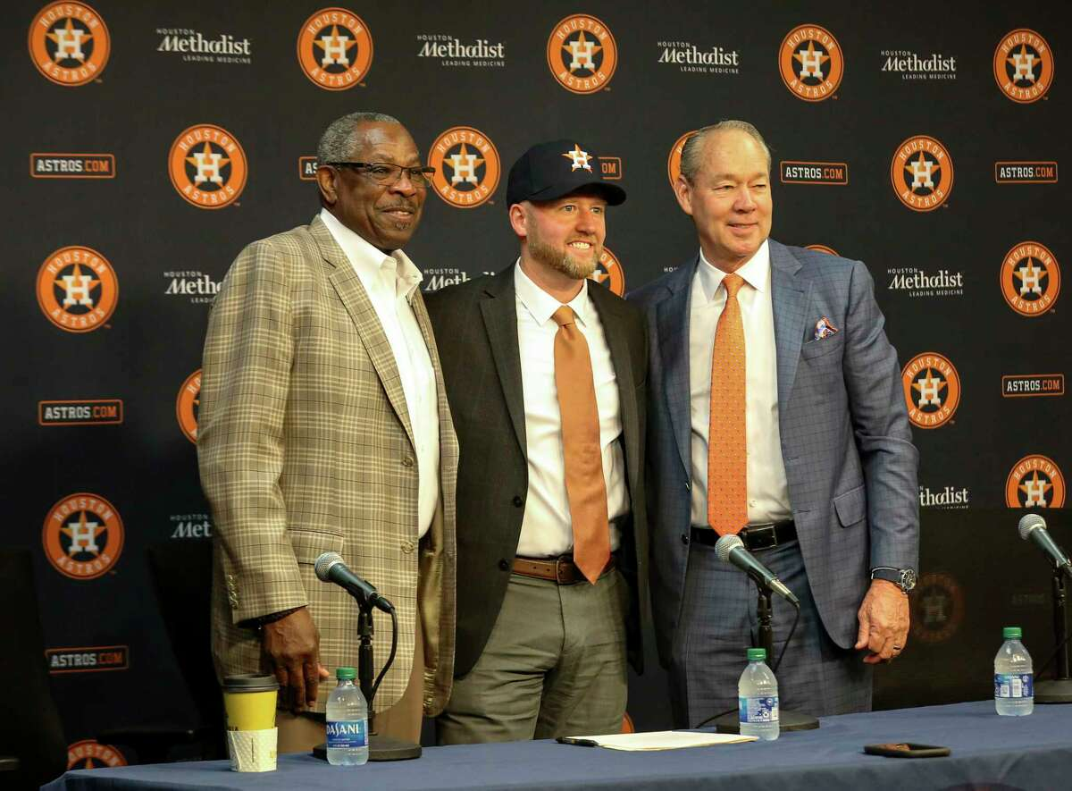 Dusty Baker, Houston Astros manager, from left, James Click, the team's newly announced general manager, and Astros owner and chairman Jim Crane pose for a photo during a press conference Tuesday, Feb. 4, 2020, at Minute Maid Park in Houston.