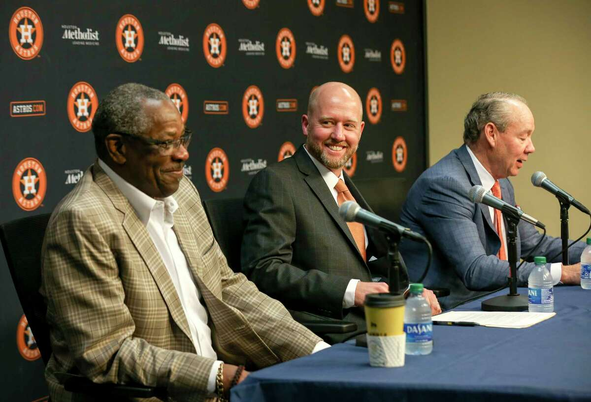 James Click (center) the Astros' newly announced general manager, laughs with manager Dusty Baker (left) and owner Jim Crane during an introductory news conference Tuesday at Minute Maid Park.