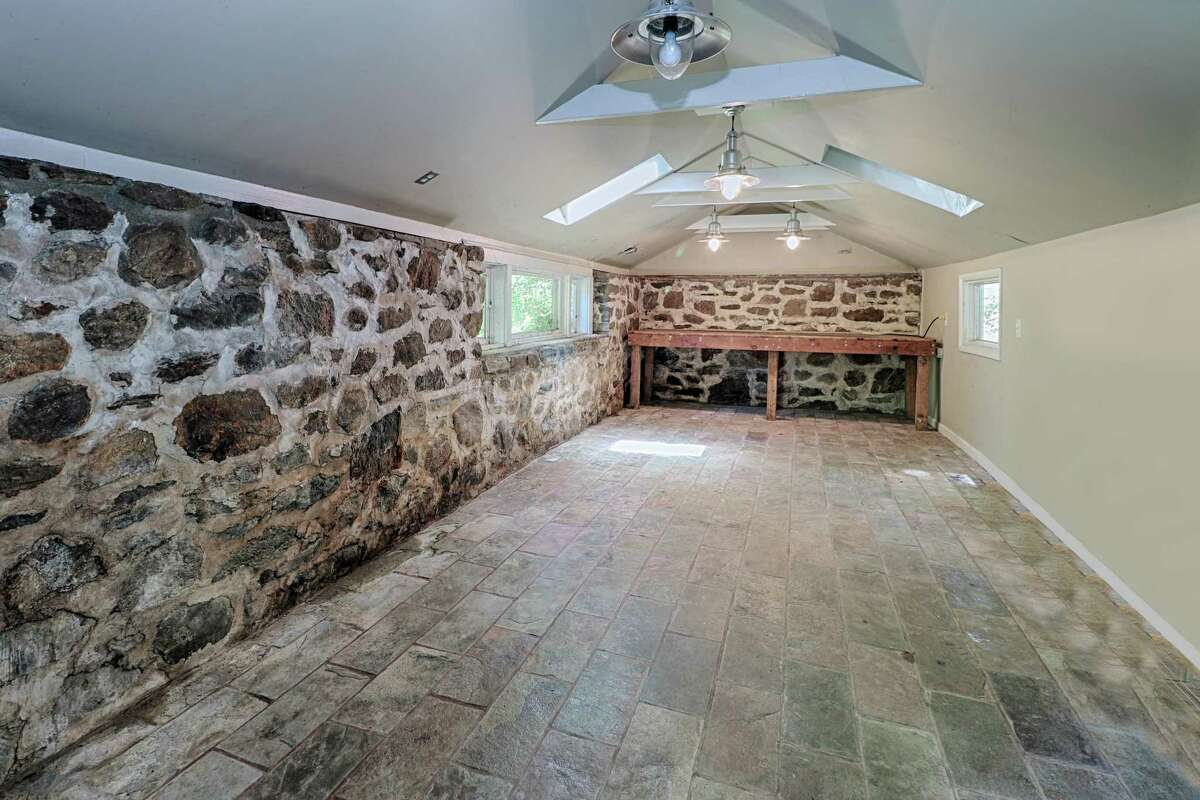 There is a heated stone outbuilding that would make a perfect art or literary studio, yoga space, or meditation room.