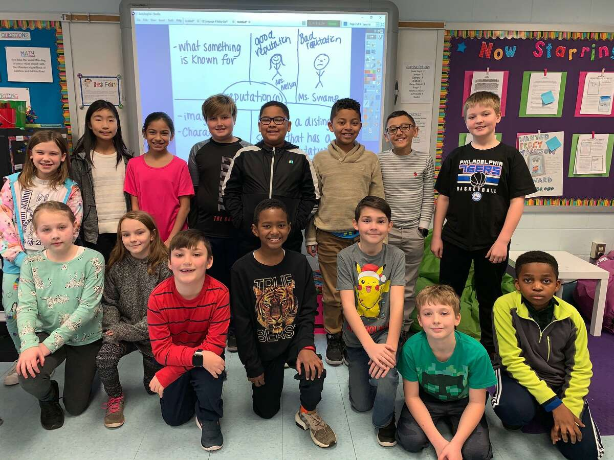 Long Hill School fourth graders after working on a vocabulary program. The school was recently tabbed by the state as a School of Distinction.
