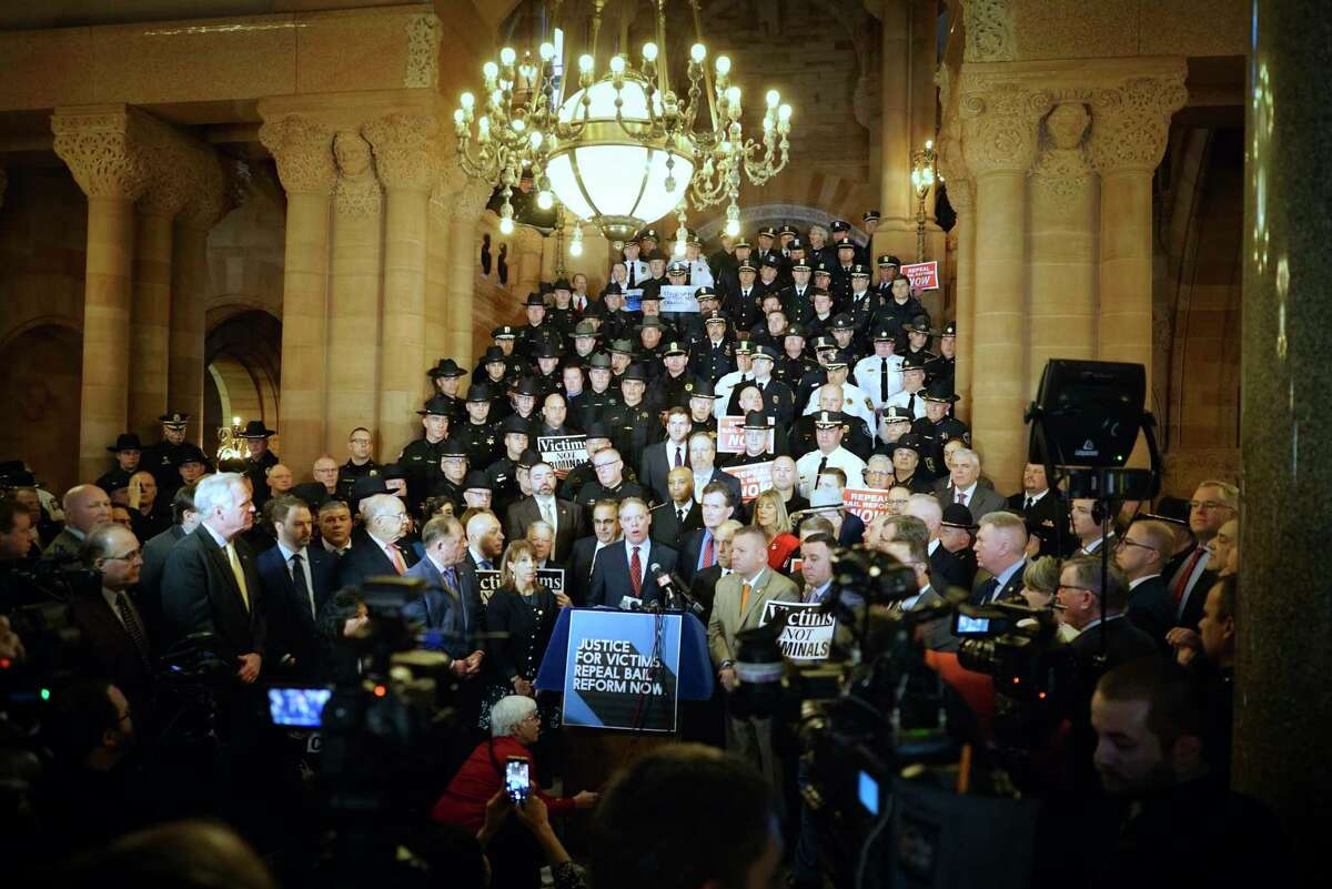 Surrounded by fellow Republican legislators and members of law enforcement from around the state, Assembly Minority Leader William Barclay, center, speaks at a rally at the Capitol calling for the repeal or amendment of criminal justice reform act on Tuesday, Feb. 4, 2020, in Albany, N.Y. (Paul Buckowski/Times Union)