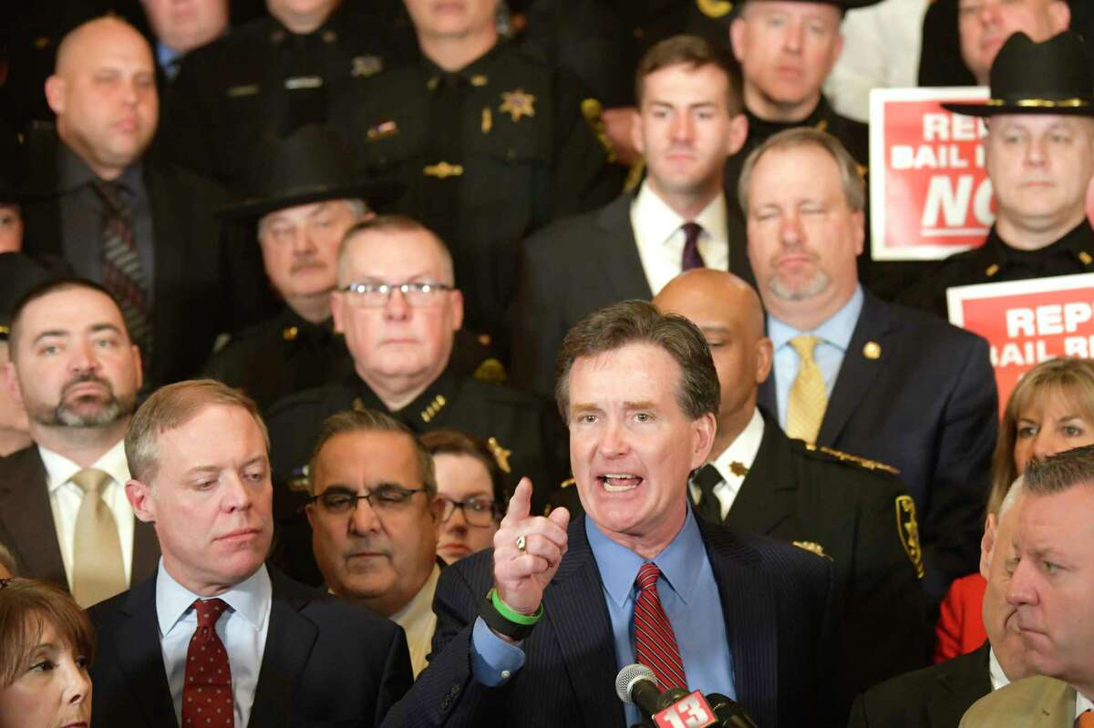 Surrounded by fellow Republican legislators and members of law enforcement from around the state, Senate Minority Leader John Flanagan speaks at a rally at the Capitol calling for the repeal or amendment of criminal justice reform act on Tuesday, Feb. 4, 2020, in Albany, N.Y. (Paul Buckowski/Times Union)