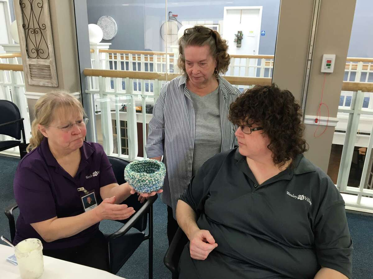 Terry Moffat, MaryAnn Griffith and Lisamarie Grailich talk about different colors and modifications they can make to the bowl pattern to accommodate larger or smaller animals.
