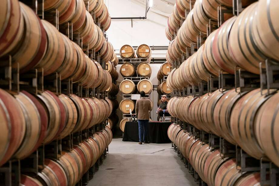 The renovated, expanded, three-story building features a large barrel room. Photo: Michael Short