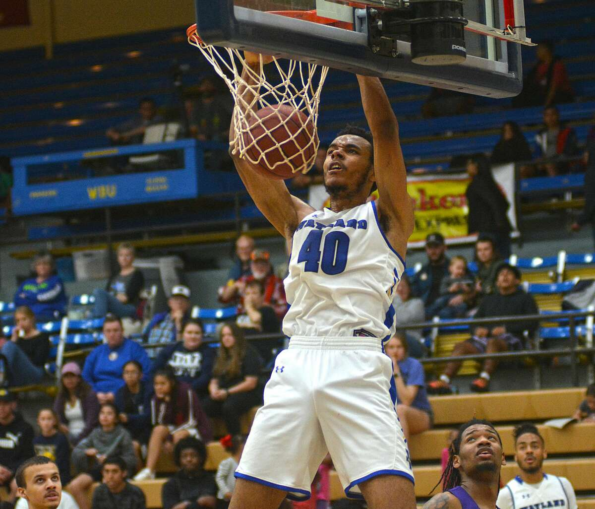 Wayland Baptist's Jibrael Washington slams in a dunk during a Sooner Athletic Conference men's basketball game against Southwestern Assemblies of God on Saturday, Feb. 1, 2020 in the Hutcherson Center.
