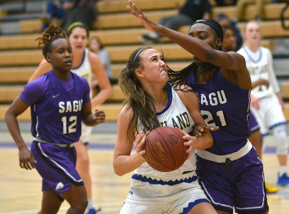 Wayland Baptist's Cailyn Breckel takes the ball inside against Southwestern Assemblies of God defender Phillipa Greene during their Sooner Athletic Conference women's basketball game on Saturday, Feb. 1, 2020 in the Hutcherson Center. Photo: Nathan Giese/Planview Herald