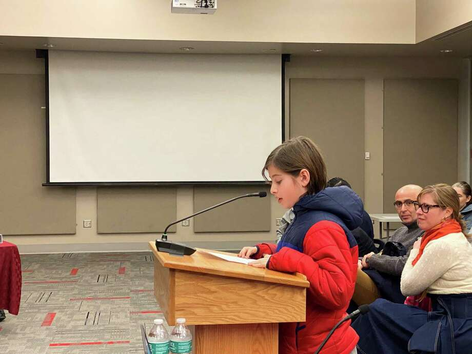 Fifth grader Jack Dalipi addressed the New Canaan Board of Education, saying he wanted to be able to walk his sister to school. He spoke in the Wagner Room at New Canaan High School on Feb. 3, 2020. Photo: Grace Duffield Hearst Connecticut Media