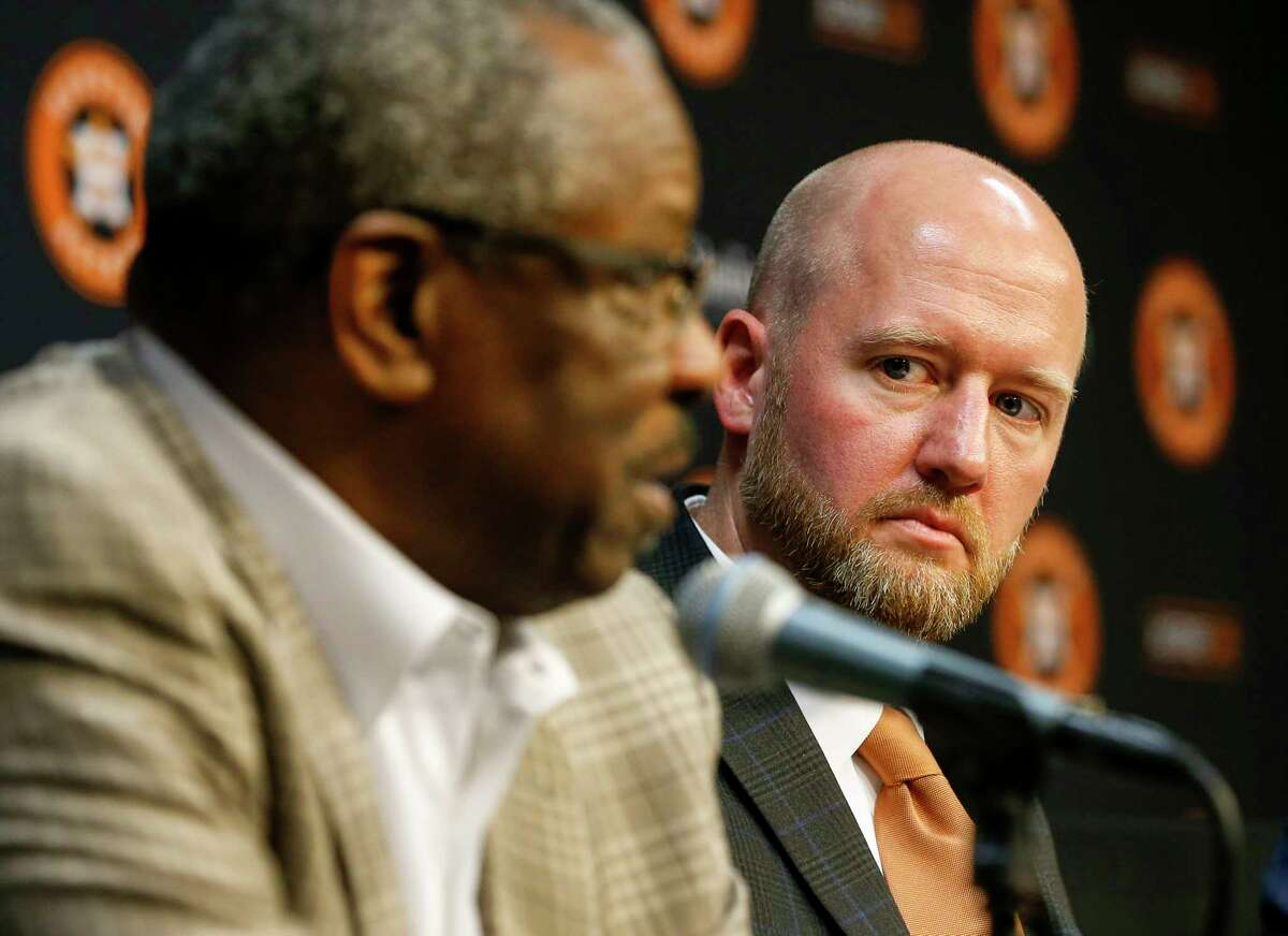 James Click, the Houston Astros' newly-hired general manager, looks at Dusty Baker, the team's manager, as he talks during a press conference Tuesday, Feb. 4, 2020, at Minute Maid Park in Houston.