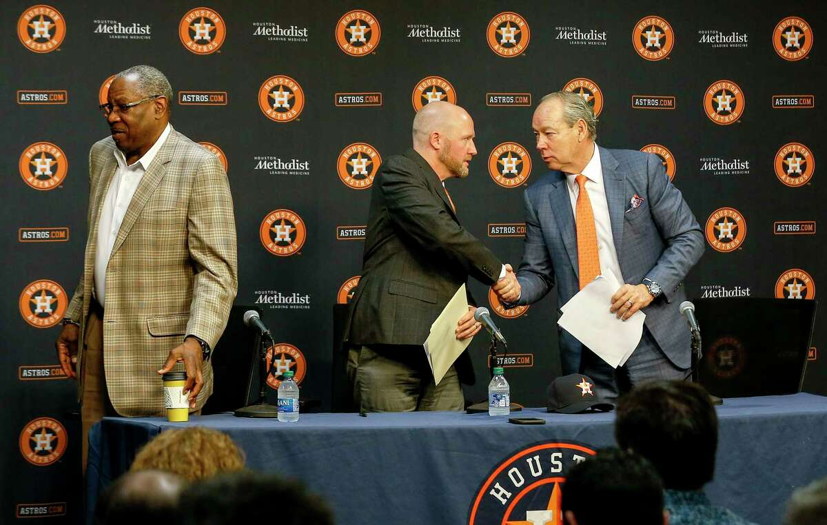 Houston Astros owner and chairman Jim Crane, right, shakes hands with James Click, the team's newly-hired general manager, after a press conference with Dusty Baker, the team's manager, Tuesday, Feb. 4, 2020, at Minute Maid Park in Houston.