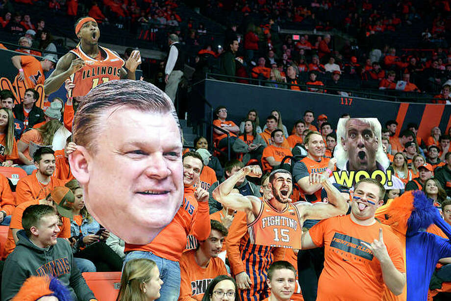 Illinois Fighting Illini fans hold up signs during last week's Big Ten game against Minnesota at the State Farm Center in Champaign. Photo: AP Photo