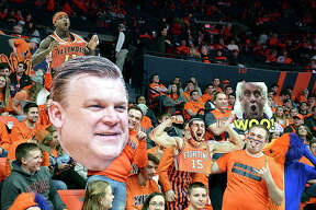 Illinois Fighting Illini fans hold up signs during last week's Big Ten game against Minnesota at the State Farm Center in Champaign.