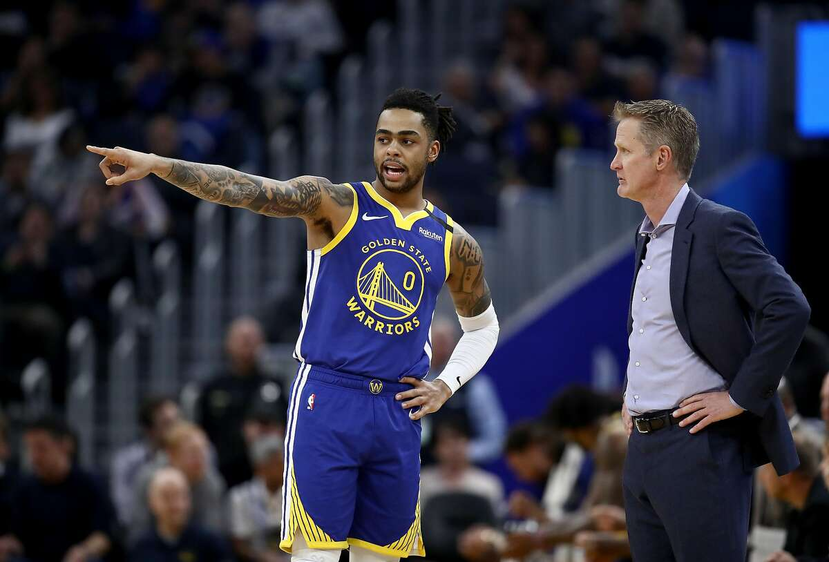 SAN FRANCISCO, CALIFORNIA - JANUARY 22: D'Angelo Russell #0 of the Golden State Warriors speaks to head coach Steve Kerr of the Golden State Warriors during their game against the Utah Jazz at Chase Center on January 22, 2020 in San Francisco, California. NOTE TO USER: User expressly acknowledges and agrees that, by downloading and or using this photograph, User is consenting to the terms and conditions of the Getty Images License Agreement. (Photo by Ezra Shaw/Getty Images)
