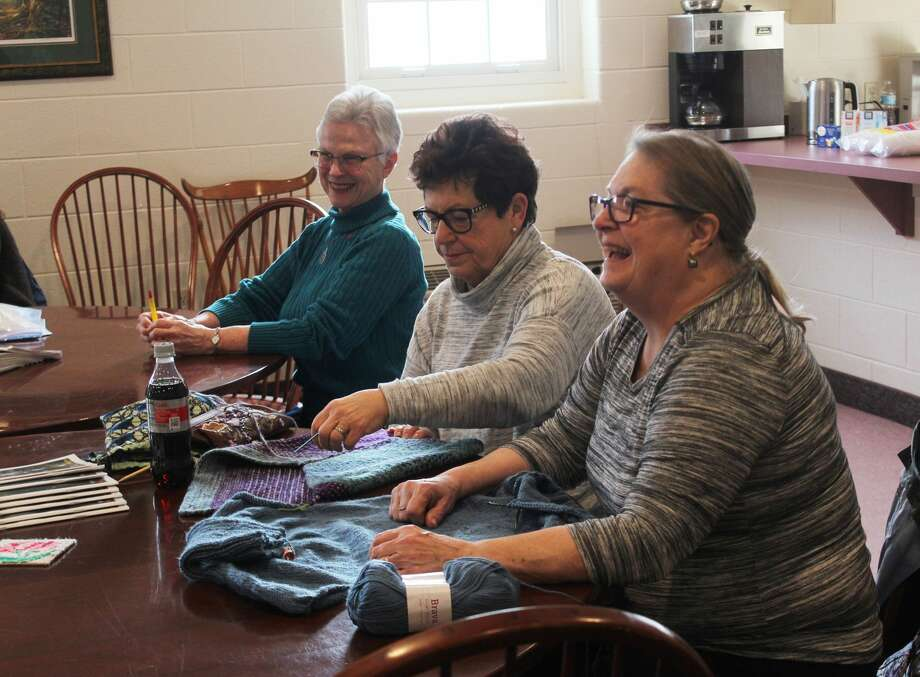 "Area residents gathered Tuesday at the United Church of Big Rapids with needles and yarn in tow to participate in a workshop hosted by Knitters Anonymous as part of the annual Festival of the Arts. This week's class was titled, ""Show and Tell,"" and encouraged participants to bring a project, unique stitch or useful technique to share with others. Photo: (Pioneer Photo/Taylor Fussman)"