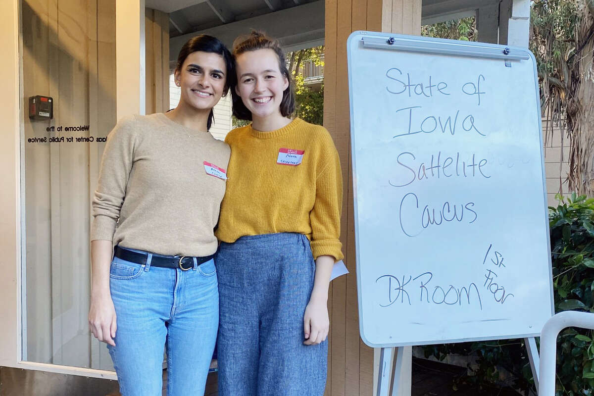 Stanford students Ahmi Dhuna and Nova Meurice made history Monday night as they organized one of the first satellite Iowa caucuses.
