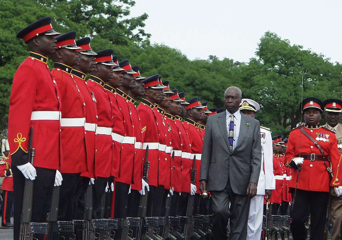 FILE - In this Saturday, Dec. 28, 2002 file photo, outgoing President Daniel arap Moi inspects a guard of honor at a barracks in Nairobi, Kenya during a parade by the armed forces in honor of the Kenyan leader. Moi, a former schoolteacher who became Kenya's longest-serving president and presided over years of repression and economic turmoil fueled by runaway corruption, has died. He was 95. (AP Photo/Salim Henry, File)