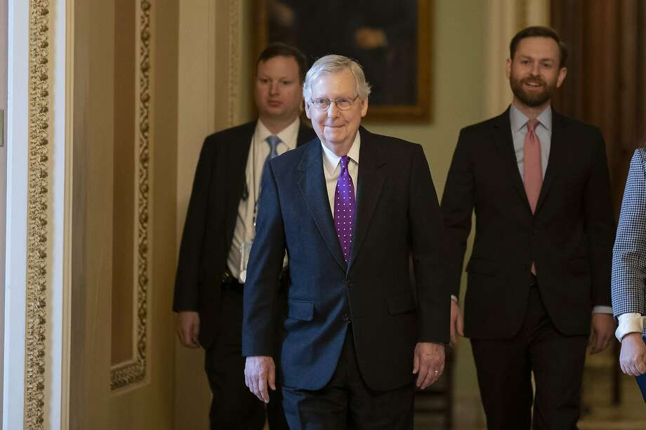 Senate Majority Leader Mitch McConnell (front) again slammed House Democrats and confirmed that he will vote to acquit President Trump. Photo: Alex Brandon / Associated Press