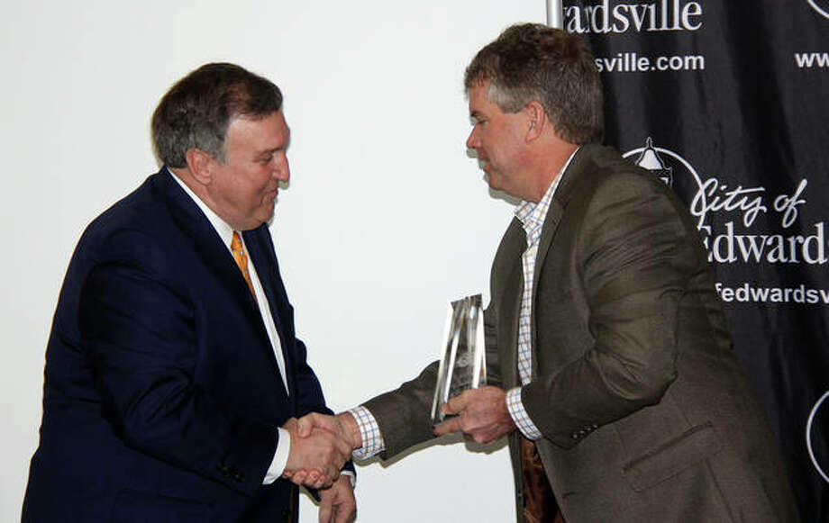 Keith Page, president and CEO of Anderson Healthcare, left, accepts the Business of the Year Award and congratulations from Mayor Hal Patton Tuesday during the city's Sixth Annual Economic Forecast Breakfast. Photo: Charles Bolinger|The Intelligencer