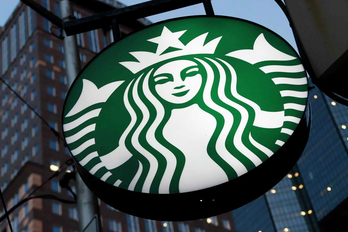 FILE - This June 26, 2019, file photo shows a Starbucks sign outside a Starbucks coffee shop in downtown Pittsburgh. The coffee chain will quit selling The New York Times, Wall Street Journal or Gannett papers like USA Today in September, citing