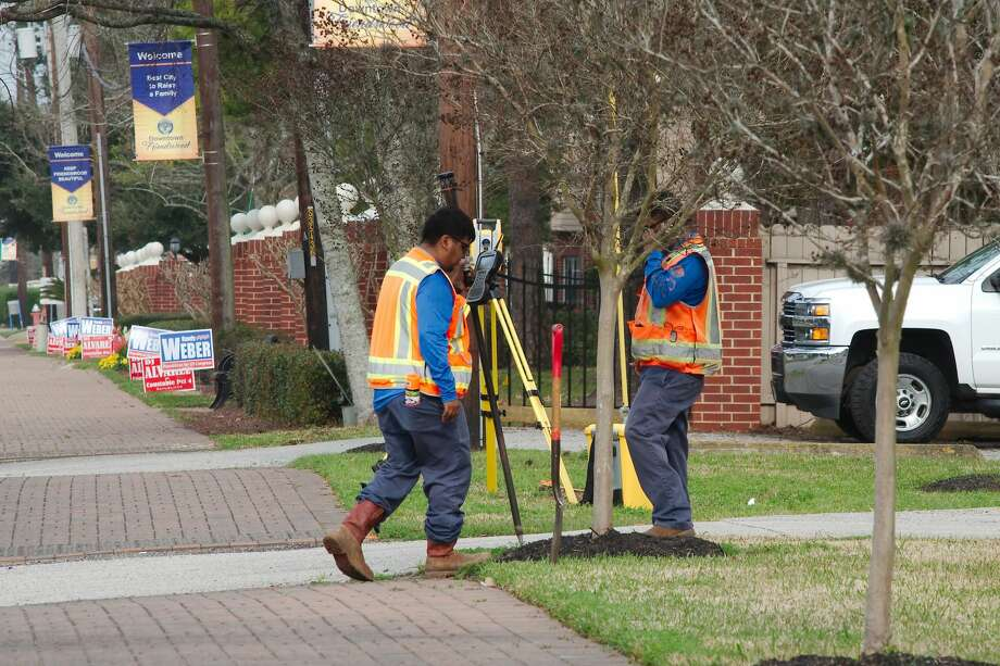 A surveying crew prepares for a median beatification project along two miles of FM 518 in downtown Friendswood. While the work is happening over the next several months, the inner lane next to the median along the work site will be closed to motorists from 9 a.m. until 3 p.m. It will be open at other times to avoid disruption to work and school rush hour. Photo: Kirk Sides/Staff Photographer