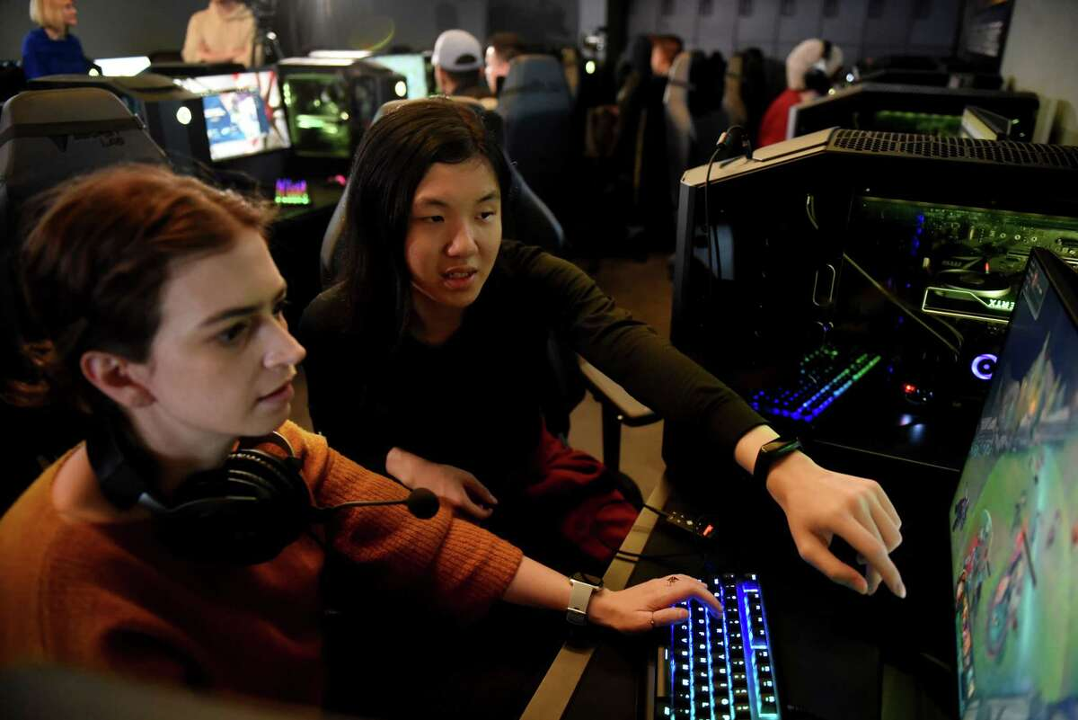 College of Saint Rose Golden Knights varsity esports team member, Wai Xian Tang coaches Times Union reporter Rachel Silberstein, left, in an in-house League of Legends tournament on Tuesday, Feb. 4, 2020, during a media event at Centennial Hall on the Saint Rose campus in Albany, N.Y. (Will Waldron/Times Union)