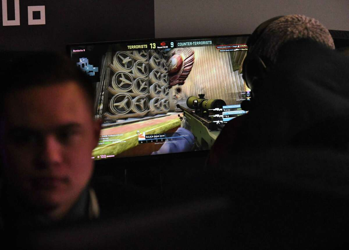 College of Saint Rose Golden Knights varsity esports team members Kameron Kelly, left, and Madden Morash, right, take part in some in-house gameplay on Tuesday, Feb. 4, 2020, during a media event at Centennial Hall on the Saint Rose campus in Albany, N.Y. (Will Waldron/Times Union)