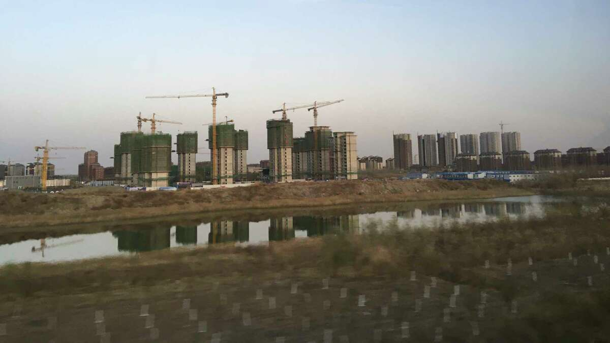 An apartment complex goes up in the new Chinese city of Binhai, which a decade ago was almost entirely farmland.