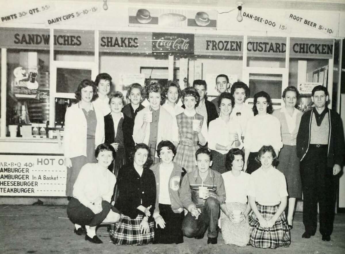 """The Conroe Flare Yearbook staff in 1960. In 1960, the Dan-Dee-Dog was owned by R.A. """"Reggie"""" Simmons. He owned the restaurant from 1959 through the early 1970s."""