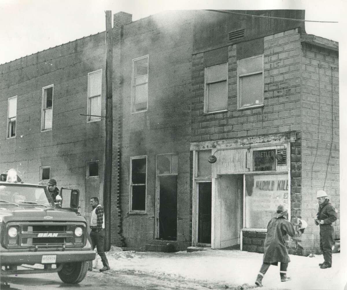 Volunteer firemen battle fire in Beaverton business district. January 1973