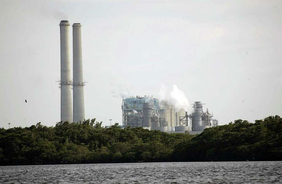 The Turkey Point Power Plant near Homestead, Fla. In December federal regulators approved Florida Power & Light Co.'s request to let the facility's twin nuclear reactors remain in operation for another 20 years beyond the end of their current licenses. Photo: J. Pat Carter, AP / AP