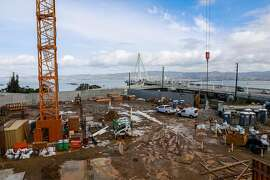 Construction workers begin to build the foundation of a condo building on Yerba Buena Island on Tuesday, Jan. 14, 2020 in San Francisco, California.