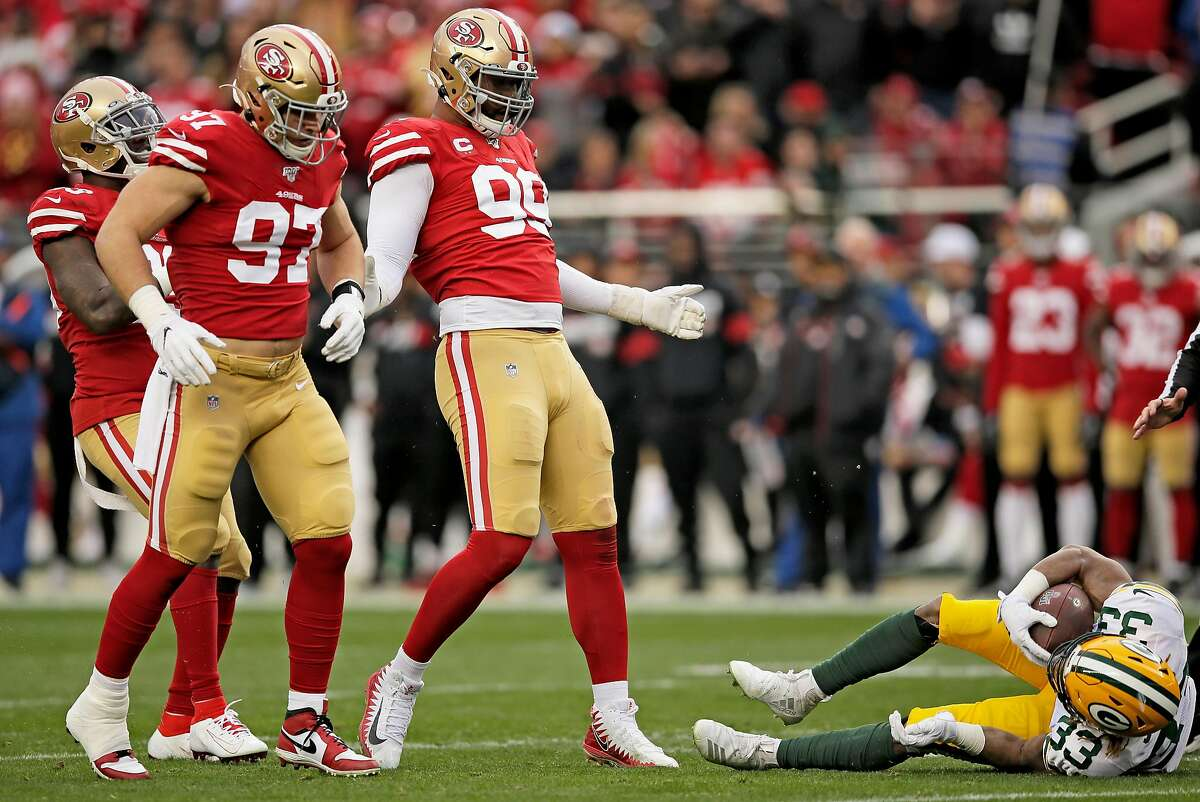 San Francisco 49ers defensive tackle DeForest Buckner (99) looks down on Green Bay Packers running back Aaron Jones (33) in the NFC Championship Game at Levi's Stadium, Sunday, Jan. 19, 2020, in San Francisco, Calif. The San Francisco 49ers won 37-20 against the Green Bay Packers. The 49ers will play the Kansas City Chiefs in the Super Bowl.