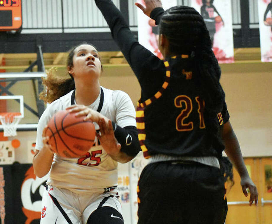 Edwardsville sophomore forward Sydney Harris drives to the basket Monday in a win over Lutheran North. Photo: Matt Kamp|The Intelligencer