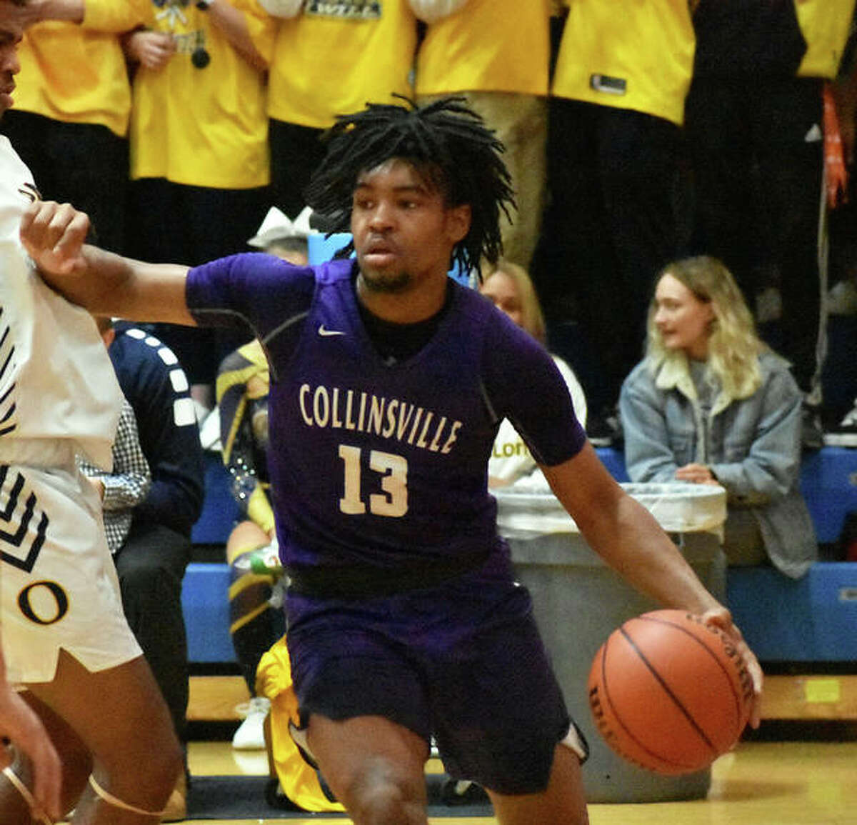 Collinsville senior guard Ray'Sean Taylor looks for space on the baseline during Friday's game at O'Fallon.
