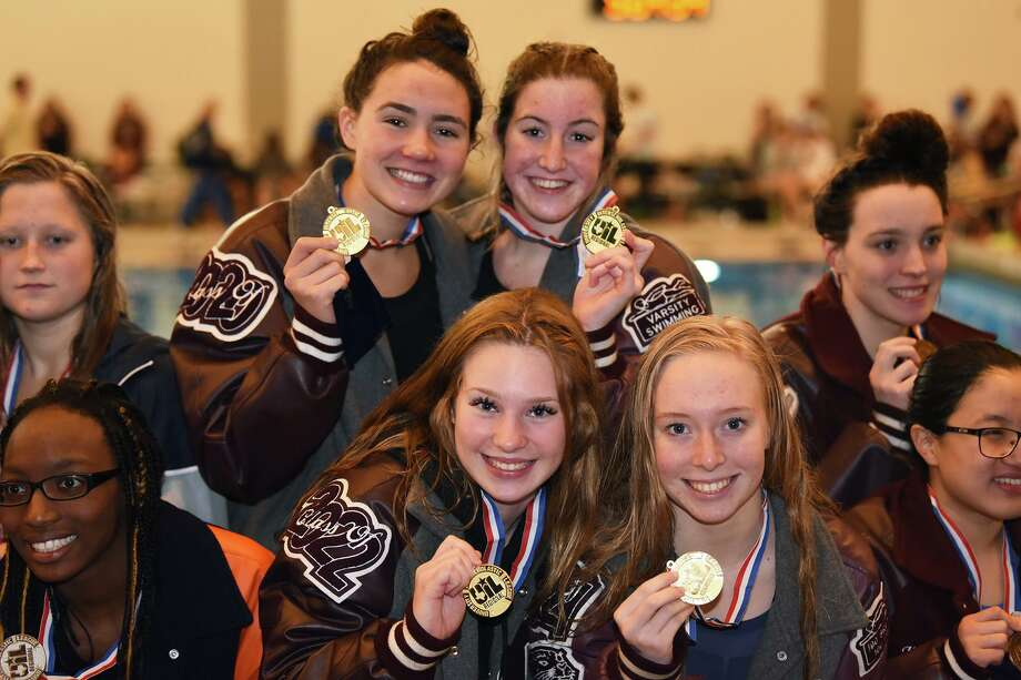 Cy-Fair's 200-yard freestyle relay team members, left, Carson Kaufmann, Reagan Jaco, Emma Ruland and Morgan Hanson finished first at the Region V-6A meet, Jan. 31-Feb. 1, at the CFISD Natatorium, to qualify for the UIL State Swimming and Diving Championships. Kaufmann also qualified in two other events, finishing first in the 500-yard freestyle and second in the 200-yard freestyle and Jaco also qualified in the 100-yard backstroke. Photo: CFISD