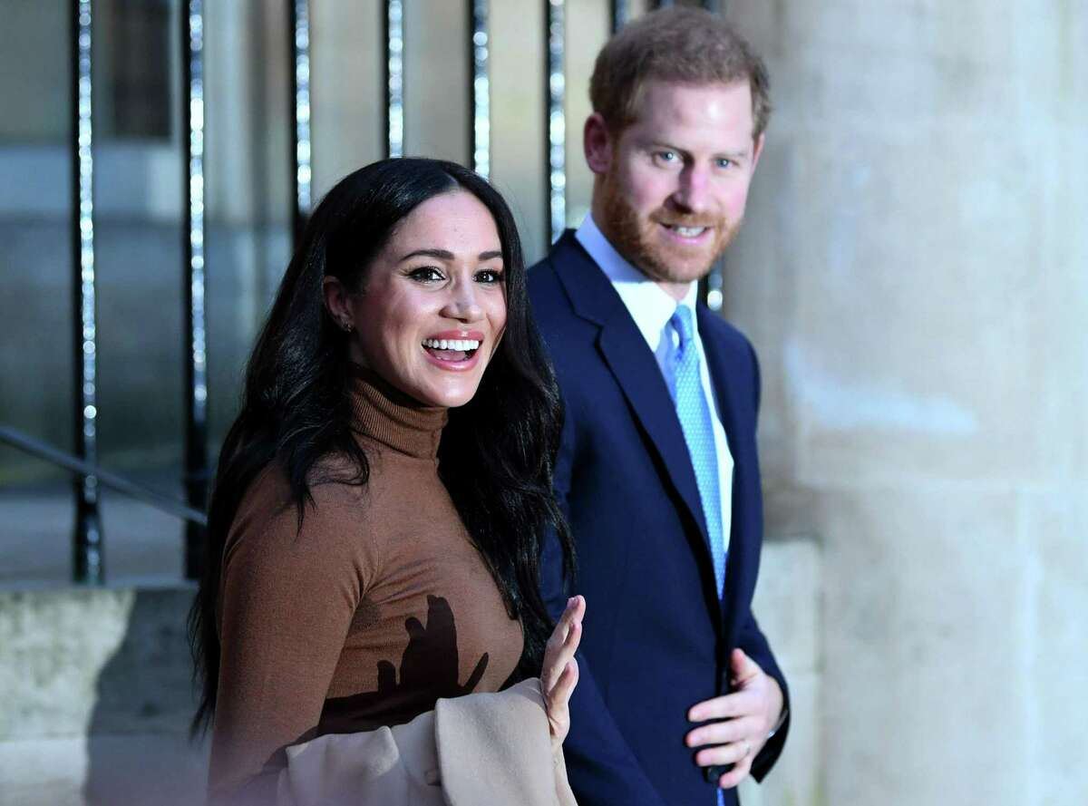 LONDON, UNITED KINGDOM - JANUARY 07: Prince Harry, Duke of Sussex and Meghan, Duchess of Sussex react after their visit to Canada House in thanks for the warm Canadian hospitality and support they received during their recent stay in Canada, on January 7, 2020 in London, England. (Photo by DANIEL LEAL-OLIVAS - WPA Pool/Getty Images)