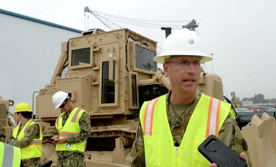 842nd Transportation Battalion Commander Gordon Vincent talks as military equipment is unloaded at the Port of Beaumont on the first day of a cargo unload. The 2,500 pieces, which arrived from Europe will be loaded onto rail cars for transport back to Fort Riley in Kansas. It is the first of three military cargo operations planned to take place at the port. Photo taken Thursday, November 7, 2019 Kim Brent/The Enterprise Photo: Kim Brent / The Enterprise / BEN