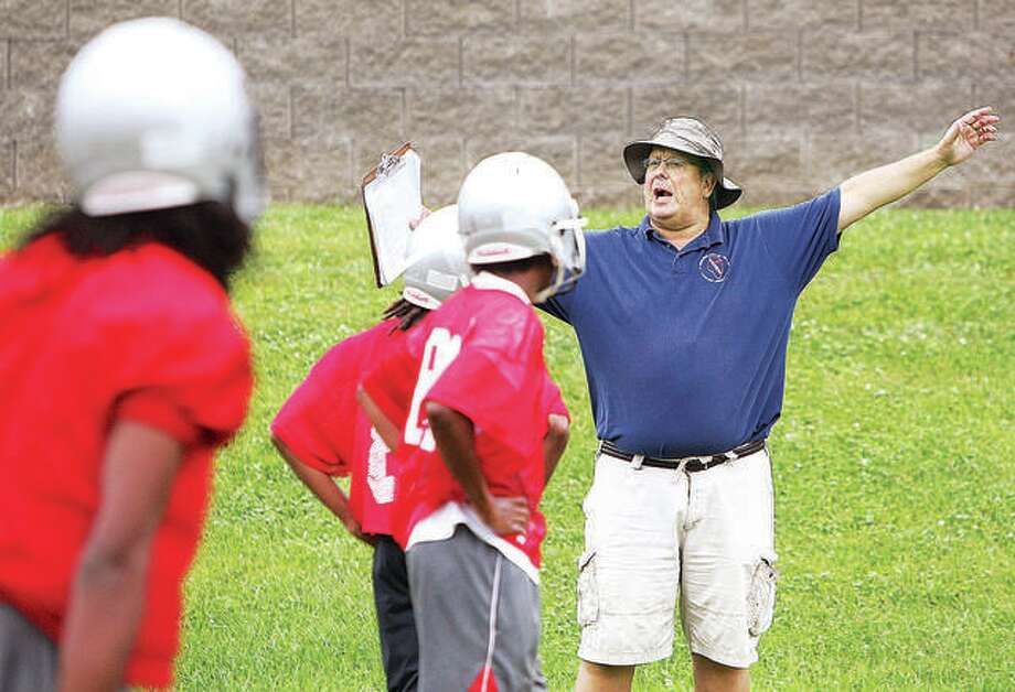Former Alton High and Southwestern High football coach Jeff Alderman, right, was elected to the Illinois High School Football Coaches Association Hall of Fame Tuesday. He is shown running a 2014 AHS preseason practice. Photo: Telegraph File Photo