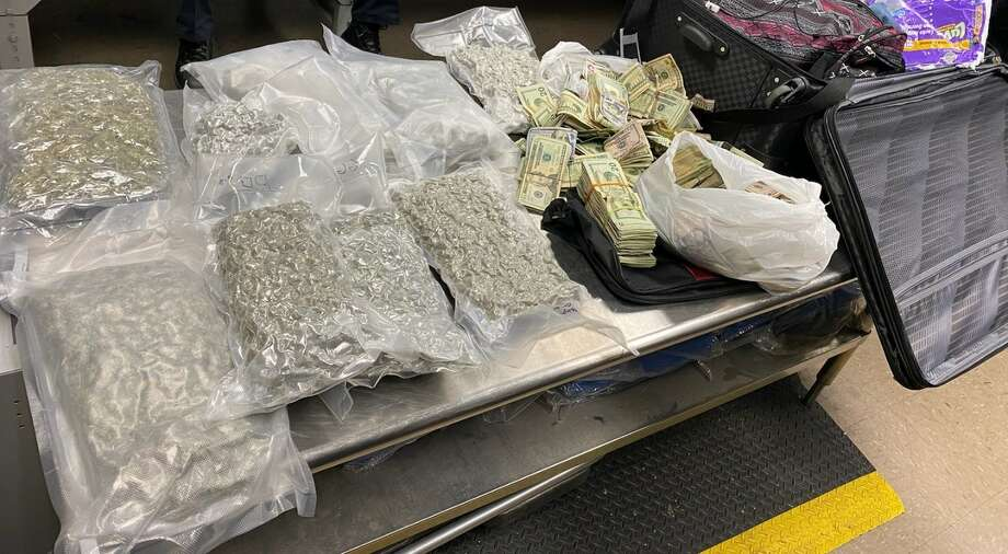 Two people were arrested and a toddler was taken into custody by Child Protective Services Feb. 3, 2020 after more than 8 lbs. of marijuana and $60,000 in cash were found in luggage at the Jack Brooks Regional Airport. Photo: Jefferson County Sheriff's Office
