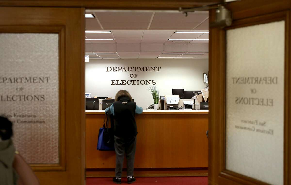 Department of elections takes questions from voters in preparations for the March 3 elections at city hall on Monday, Jan. 27, 2020, in San Francisco, Calif.
