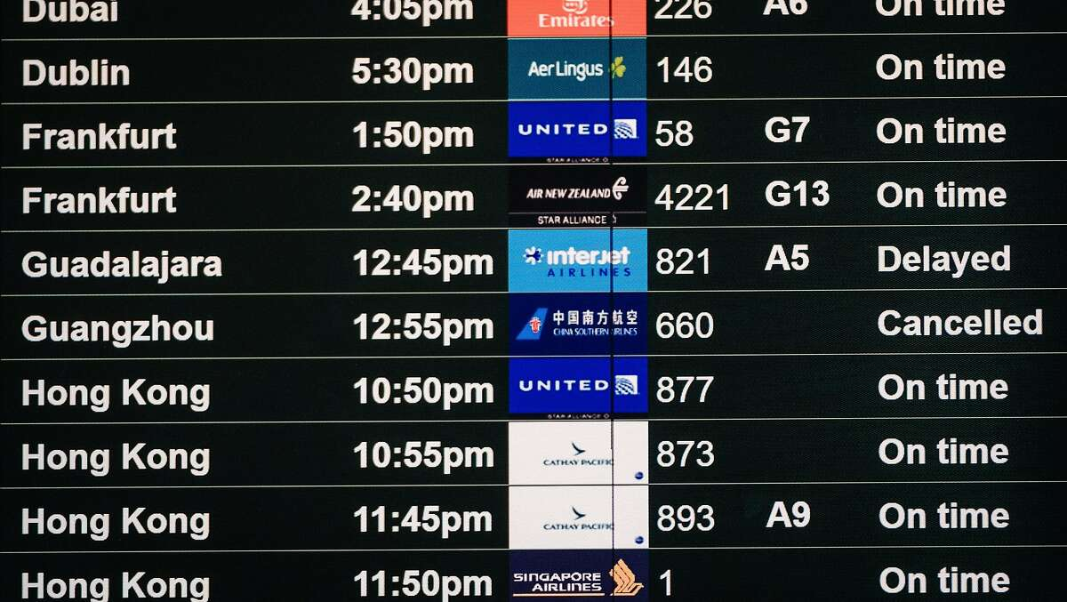 A flight departure board showing a flight to Guangzhou China as canceled is seen on the International departures level at San Francisco International Airport in San Francisco, Calif. on Tuesday, February 4, 2020.