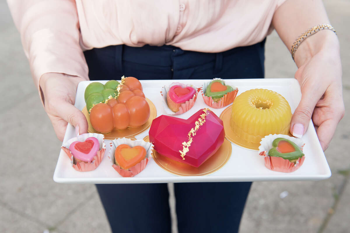 Olia Rosenblatt shows us an assortment of cakes in front of her boutique storefront.