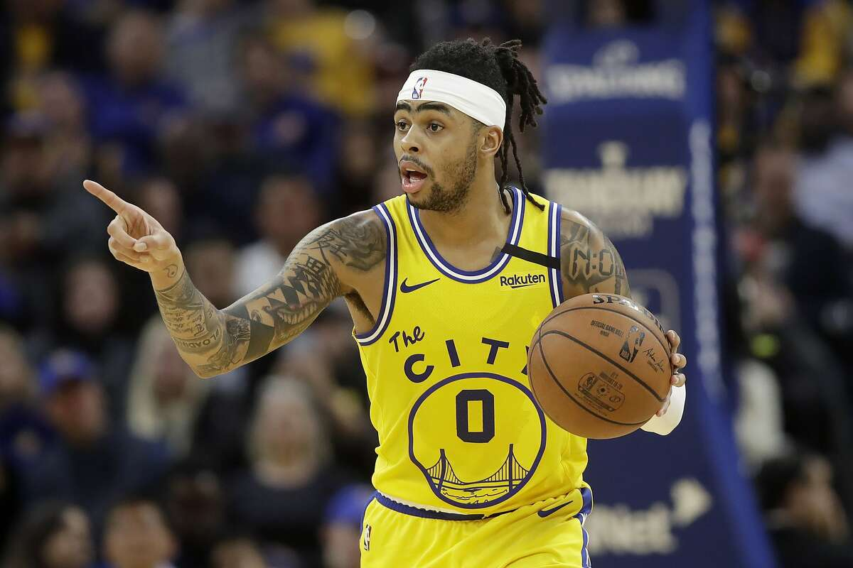 Golden State Warriors guard D'Angelo Russell (0) dribbles the ball up the court against the Indiana Pacers during the second half of an NBA basketball game in San Francisco, Friday, Jan. 24, 2020. (AP Photo/Jeff Chiu)