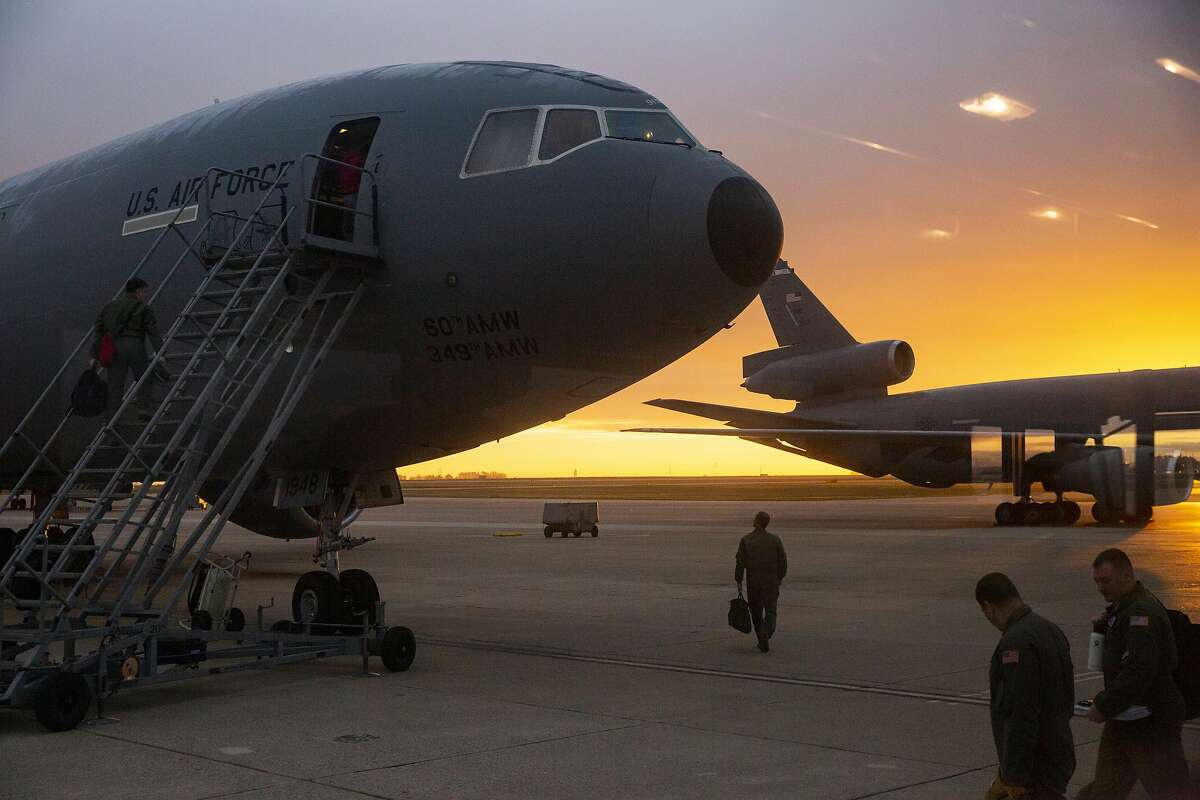 Members of the 60th Air Mobility Wing and 349th AMW board their military aircraft for an air mobility mission from Travis Air Force Base on Tuesday, Jan. 28, 2020, in Fairfield, Calif.