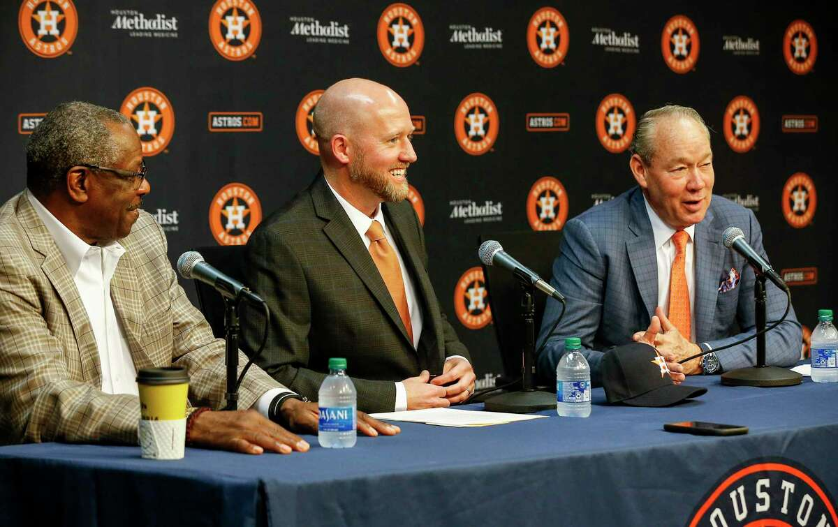 The Astros were all smiles when James Click, center, was introduced as the team's GM on Tuesday but it wasn't enough to erase the sign-stealing scandal that hovers over the team.