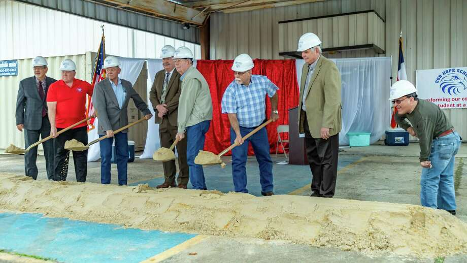 The Superintendent and Board of Trustees lift ceremonial shovels of dirt as the Hughen Center Inc. and Bob Hope School held a groundbreaking ceremony for the start of construction for the new Bob Hope High School campus along Highway 73 in Port Arthur on February 4, 2020. Pictured from left are Dr. Bobby Lopez, Bobby Simon, Cesar Munoz, Randy Kimler, Mike Casey, Mark Mulliner, Dr. Gary Stretcher, and Al Agudelo. Fran Ruchalski/The Enterprise Photo: Fran Ruchalski/The Enterprise / 2019 The Beaumont Enterprise