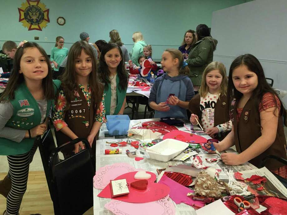 Girls from Girl Scout Troops 40324 and 40067, from left to right, Lydia Hyde, Sonya Hyde, Lucy Roman, Skyann Kivale, Emma Wellington and Alys Hyde make Valentine cards. Photo: Courtesy Of Roger Sherman Chapter, DAR / The News-Times Contributed