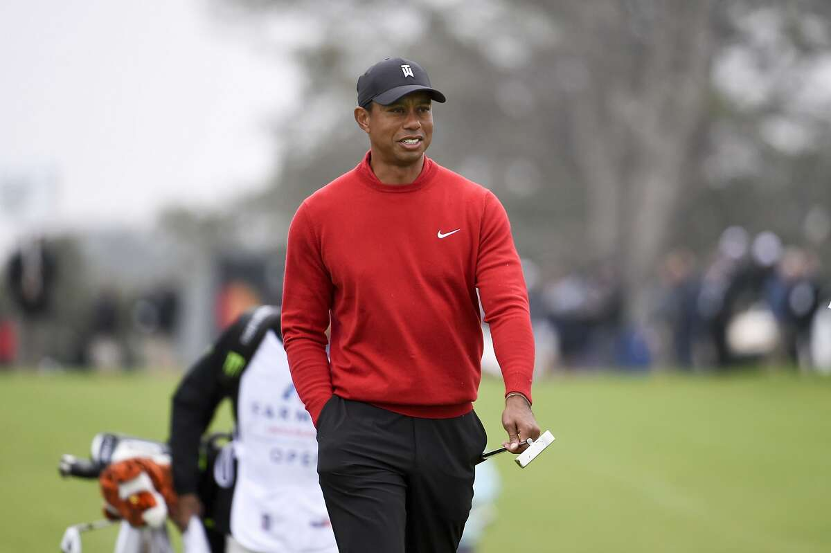 Tiger Woods walks to the green on the second hole of the South Course at Torrey Pines Golf Course during the final round of the Farmers Insurance golf tournament Sunday Jan. 26, 2020, in San Diego. (AP Photo/Denis Poroy)