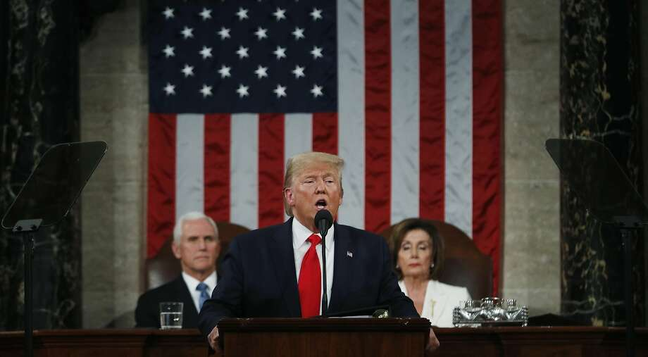 President Donald Trump delivers his State of the Union address to a joint session of Congress in the House Chamber on Capitol Hill in Washington, Tuesday, Feb. 4, 2020, as Vice President Mike Pence and Speaker Nancy Pelosi look on. (Leah Millis/Pool via AP) Photo: Leah Millis, Associated Press